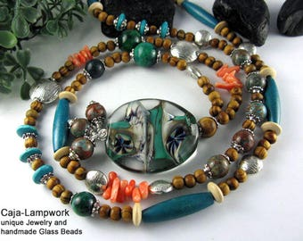 Long necklace with large lampwork bead, turquoise, wood and coral