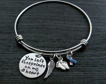 You left footprints on my heart / Miscarriage Infant Loss Jewelry / Hand Stamped Wire Bangle Bracelet