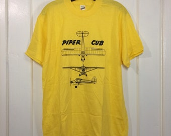 deadstock 1980s Piper Cub patent drawing small airplane t-shirt size XL 21x27.5 pilot aircraft thin yellow Screen Stars made in USA NOS
