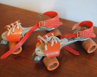 rollerskate orange plastic metal roller skates