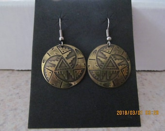 "1""handcrafted brass earrings with laser etched aztec design and surgical steel ear wires."