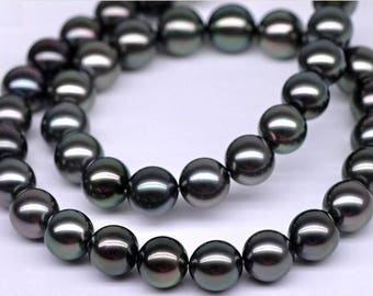 Black 8 MM round shell beads.