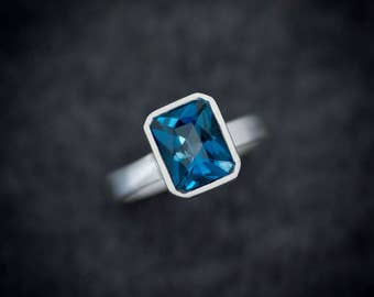London Blue Topaz Ring, Radiant Cut Solitaire Gemstone Ring in Argentium Silver, Bezel Set Wide Band Ring