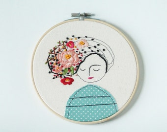 Embroidery Hoop Art of a Girl with Flowers in Her Hair