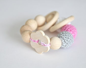 Big flower toy. Teething wooden rattle with grey, pink and white crochet wooden beads and 2 wooden rings.