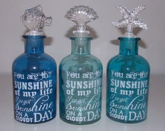 3 decorative glass bottles with corks sea
