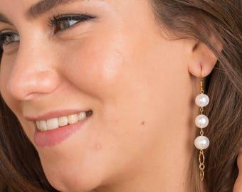 Golden earrings, white fresh water pearls.