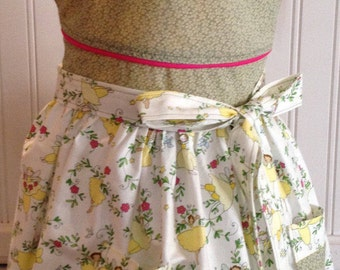 Vintage style girls full apron yellow ballerinas green bodice pink trim pockets pink waist trim offset neck ties round neck full apron
