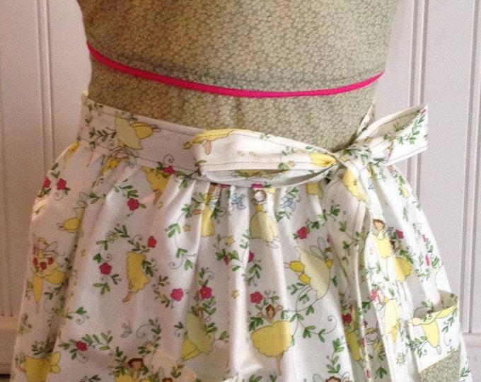 Vintage style girls full apron yellow ballerinas green bodice pink trim pockets pink waist trim offset neck ties round neck full apron