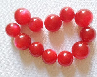 Bracelet  - chunky iridescent moon glow moonglow red plastic bead bracelet