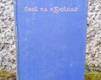 Irish language antique book, in Gaelic script, Ceol na nGiolcac by Padraic Og O Conaire. Ireland antique, Celtic, archaic, Gaeilge.
