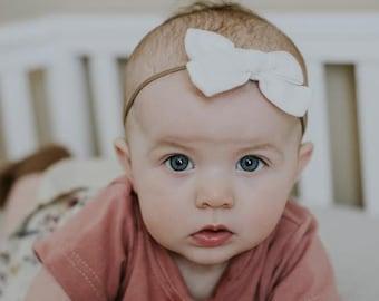 Light Ivory Abigail Organic Double Gauze Fabric Bow Headband | Baby Girl Nylon Headbands | Tiny Tied Bow Clip