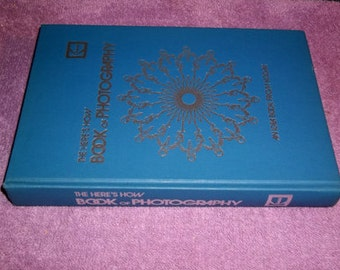 The Here's How Book Of Photography 1973 published by Kodak, blue hardcover with dust jacket