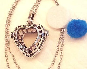 Heart shaped essential oils locket.