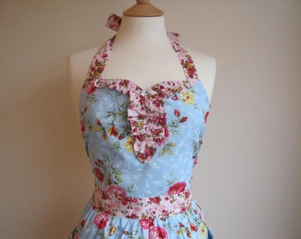 Retro apron with curved ruffles, vintage floral fusion pattern on blue fabric. 1950s inspired, fully lined.