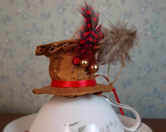 Mad Hatter Hat style ornament copper red and black hat pins and feathers