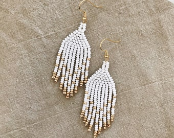 Beaded native american earrings in white and gold