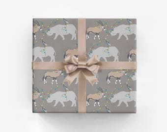 Christmas Wrapping Paper with Rhinoceros and Antelope Whimsical Safari Animal Gift Wrap with Rhino and Oryx and Christmas Lights