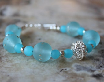 pale turquoise ocean blue and silver lampwork bracelet