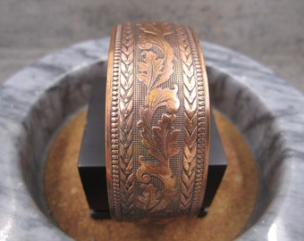 An etched copper cuff bracelet