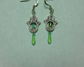 Mint green Buddha hand and dagger dangle earrings