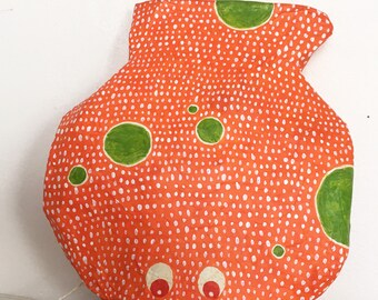small neon orange Japanese fish with green dots