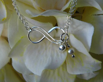 Sterling silver Infinity chain bracelet with Swarovski pearls & sterling silver puffed heart charm