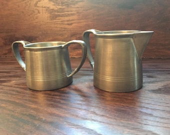 Vintage heavy Colonial Pewter sugar and creamer set