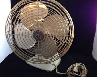 Mid-Century Vintage General Electric 1 Speed Oscillating Fan Cat. No. F13PG10 Working Condition Tan Metal With Full Cage    01648