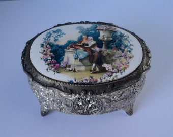 Vintage silver tone Ornate metal With Large Porcelain  lovers Scene  on the lid Jewelry  Musical Box.