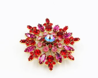Large Starburst gold tone brooch with deep pink rhinestones