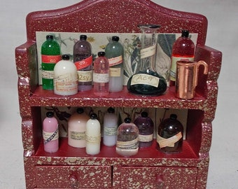 Dolls House Miniature Witch / Wizard Small red/gold potion/poison display.