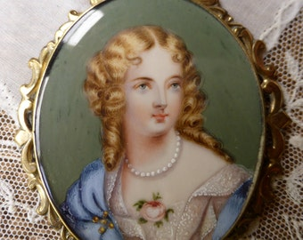 Antique Hand painted Miniature Portrait has been worn on a ribbon as necklace.