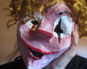 Mask from paper mache. Clown. Harlequin. It. Clown.