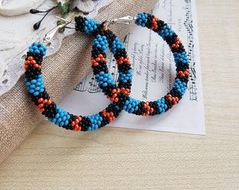 Native america inspired beaded hoop earrings Pierced stud earrings Huichol Blue black orange Beadwork snake serpent circle jewelry Big hoops