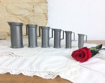 Graduated Pewter Measuring Jugs. Antique Set of Six Metal Pitchers