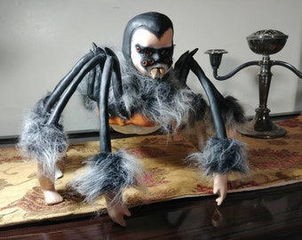 OOAK porcelain doll. Rebuilt and sculpted into Spider Baby. Gothic horror art doll.
