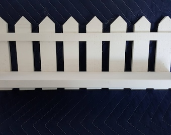 Shelf with white picket fence for a no place  like home experience tht you can hang anyplace in your home