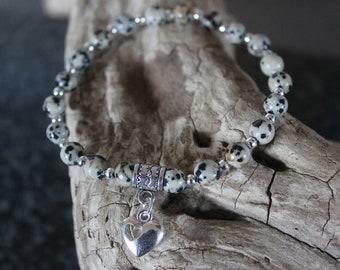 Lovely bracelet with semi precious Dalmation Jasper beads and heart charm.