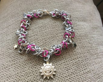 Sun and stars shaggy loops style, pink, white, and silver charm bracelet