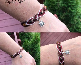 Friendship bracelet with cute little turtle