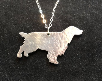 Textured sterling silver dog silhouette pendant.