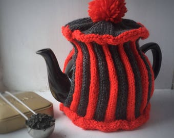 Handknitted striped medium tea cosy