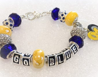 University of Michigan jewelry GO Blue bracelets body Bling with dangling logo charm. These are VERY different and have a FANTASTIC fit.