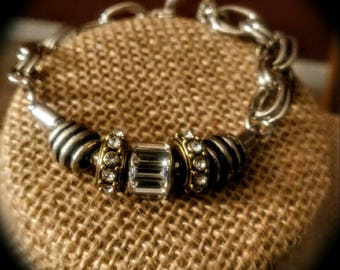"Silver Bracelet - ""Unified Treat"" Silver bracelet with gold toned rustic look embedded swarovski elements charms."