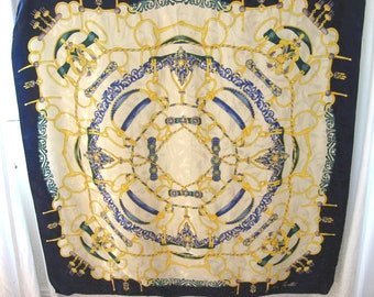 Silk Scarf from Italy, by Andrea Zanellato. Quality bridles and Stirrups equestrian themed large neck wrap. Blue, cream & gold with pattern.