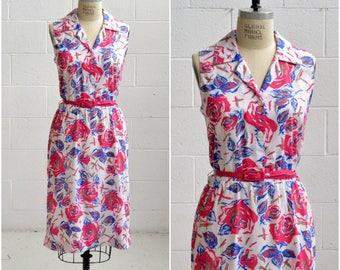 70s pink floral shirt dress · bright pink blue a line midi dress · sleeveless dress with belt · long preppy mad men dress · large