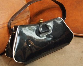 Vintage Shiny Black Vinyl Framed Clasp purse with leather lining and clasp latch