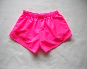 Pink Shorts enhances all figures. Low Rise Pink Shorts are often worn by sororities.