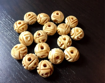 12 mm Antiqued Carved Bone Round Beads ... 17 ct.